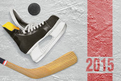Hockey skates, stick and puck Royalty Free Stock Photography