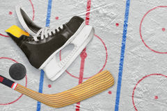 Hockey skates, stick and puck Stock Photo