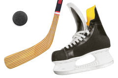 Hockey skates, stick and puck Stock Photography