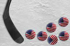 Hockey stick and american pucks. The stick and the American washers on the ice of the hockey field. Concept, background, hockey Stock Photo