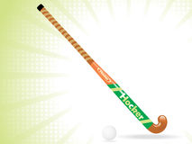 Hockey stick and ball with white rays background Stock Image