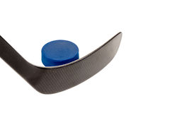 Hockey stick and blue puck Royalty Free Stock Photos
