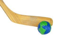 Hockey stick and a globe Royalty Free Stock Image