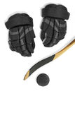 Hockey stick, gloves and puck Stock Photo
