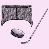 Hockey stick, hockey goal and puck Royalty Free Stock Photos