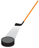 Hockey stick and hockey puck Royalty Free Stock Photography