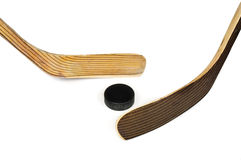 Hockey stick and puck Royalty Free Stock Photos