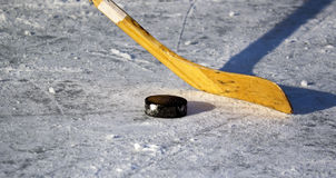 Hockey stick and puck Royalty Free Stock Photo