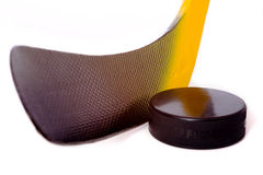 Hockey Stick and Puck. A colorful hockey stick and puck on a white background.  The words on the puck say official and Chezk.  They are not trademarks they Royalty Free Stock Image