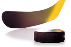 Hockey Stick and Puck. A colorful hockey stick and puck on a white background.  The words on the puck say official and Chezk.  They are not trademarks they Stock Images