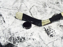 Hockey stick and puck. Detail of a hockey stick and puck Royalty Free Stock Photos