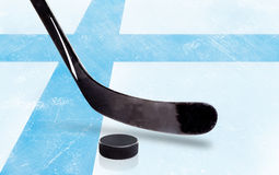 Hockey Stick and Puck With Finland Flag on Ice Stock Images