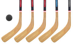 Hockey stick and puck. Five hockey sticks on a white background. Isolated Royalty Free Stock Photography