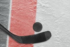 Hockey stick, puck and fragment of the ice arena with black and. Hockey accessories on the ice hockey arena. Concept, hockey stock images