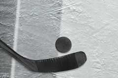 Hockey stick, puck and fragment of the ice arena with black and gray lines. Hockey accessories on ice hockey arena. Concept, hockey, wallpaper stock photo