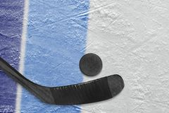 Hockey stick, puck and fragment of the ice arena with blue lines. Hockey accessories on the ice hockey arena. Concept, hockey stock images