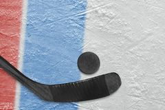 Hockey stick, puck and fragment of the ice arena with blue and r. The stick, puck, blue and red lines on the ice hockey arena. Concept, hockey stock photos