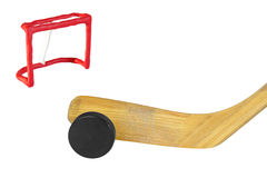 Hockey stick, puck and goal Stock Photos