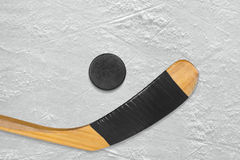 Hockey stick and puck Stock Images