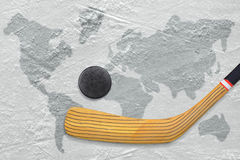 Hockey stick and puck on the ice Stock Photography