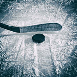 Hockey Stick and Puck. On the Ice Rink Royalty Free Stock Images