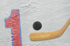 Hockey stick, puck and the numeral one Stock Image