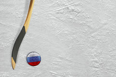 Hockey stick and puck Russian Royalty Free Stock Images