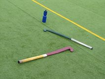 Hockey sticks. On playing-field royalty free stock photography