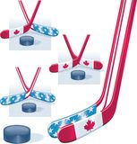 Hockey sticks and puck. Hockey sticks in USA and Canada flag colors and puck Royalty Free Stock Photography