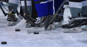 Hockey sticks, pucks and skates Royalty Free Stock Photography