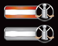 Hockey sticks and trophy on checkered tabs. Orange and silver checkered tabs with a hockey trophy and crossed sticks Royalty Free Stock Images