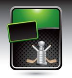Hockey sticks and trophy on green advertisement. Hockey sticks and trophy on green and black halftone advertisement Royalty Free Stock Image