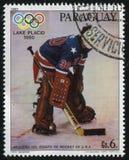Hockey team from the USA at Winter Olympics at Lake Placid. RUSSIA KALININGRAD, 19 APRIL 2017: stamp printed by Paraguay, shows the hockey team from the USA at Royalty Free Stock Photos