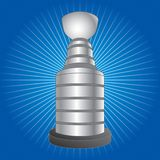 Hockey trophy on blue starburst Royalty Free Stock Images