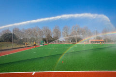 Hockey Water Spraying Play Astro Field Stock Photos