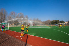 Hockey Water Spraying Play Astro Field Royalty Free Stock Image