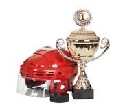 Hockeyhjälm och puck Royaltyfri Fotografi