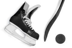 Hockeystok, vleten en puck stock afbeeldingen