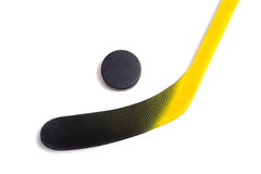 Hocky Stick and Puck on White Royalty Free Stock Images
