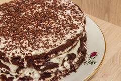 Сhocolate cake is soaked in sour cream Royalty Free Stock Photography