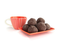 Сhocolate candies with cup of tea Royalty Free Stock Photography