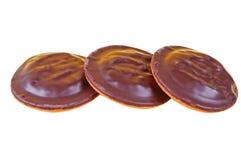 Сhocolate cookies isolated background close up. Three chocolate cookies isolated background close up Stock Photo