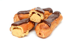сhocolate eclairs isolated on white Stock Images
