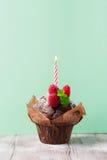 Сhocolate muffin with fresh raspberries Stock Photos