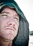 Hodded Man. A man with an intense stare wearing a hood Stock Photo