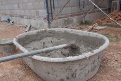 Hoe in Cement mixing in truck for buildings construction. Royalty Free Stock Photo