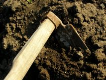 Hoe in garden. Detail photo of the hoe in garden Royalty Free Stock Photography