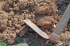 Hoe and soil Royalty Free Stock Photography