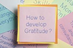 Hoe te die Dankbaarheid te ontwikkelen op een nota wordt geschreven stock afbeelding