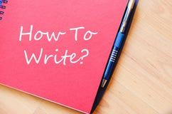 Hoe te schrijven schrijf op notitieboekje stock afbeeldingen